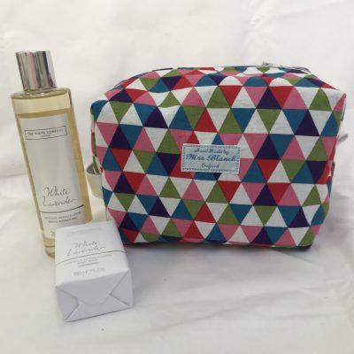Multi coloured geometric design wash bag £15.00